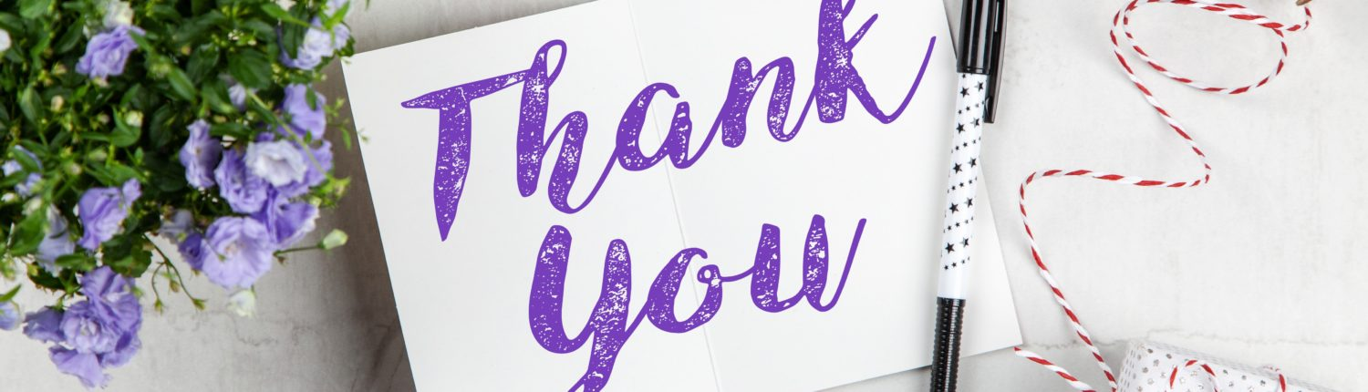 Thank you card with flowers and a pen